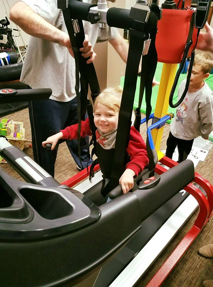 Pediatric Child on the peds treadmill with their specific sized halter