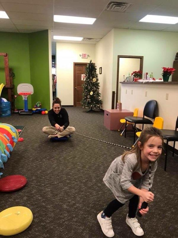 Therapy fun--- patient pulling a therapist