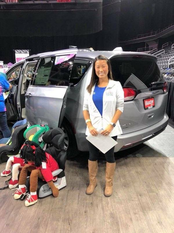 Mandi, one of our Physical Therapists working a fair for car seat safety.