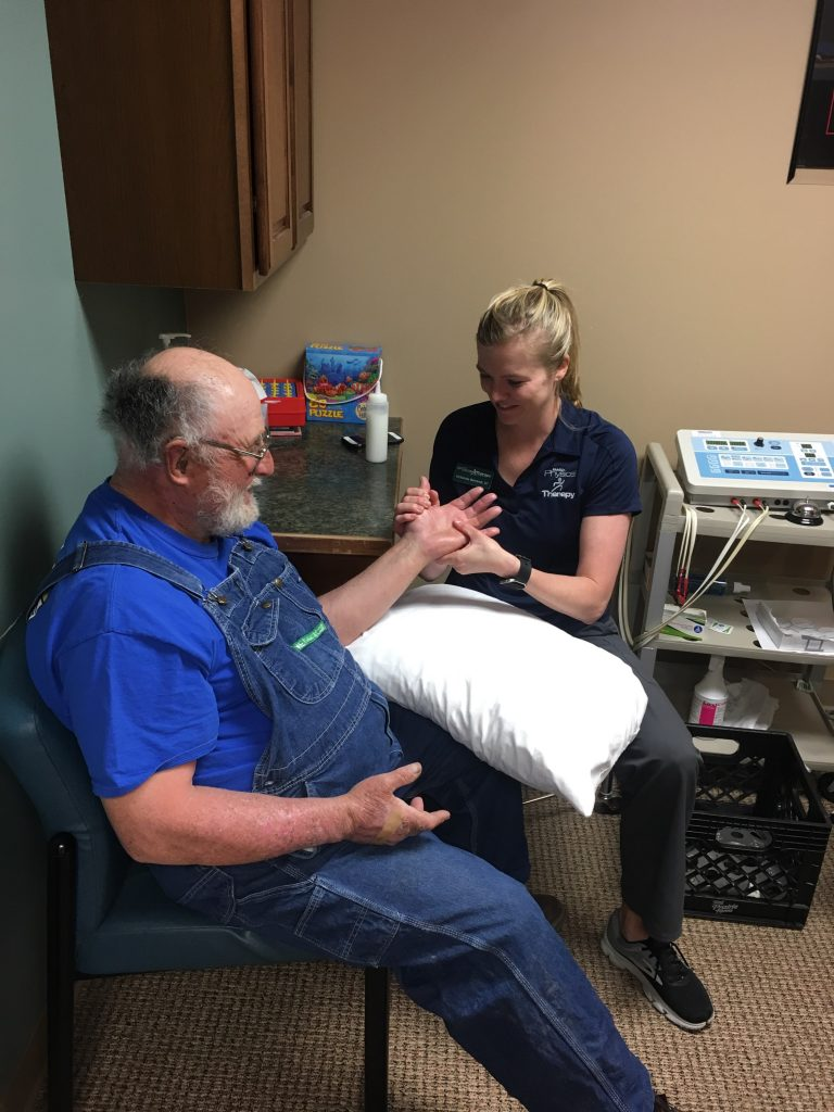 Occupational Therapist working on hand therapy with patient