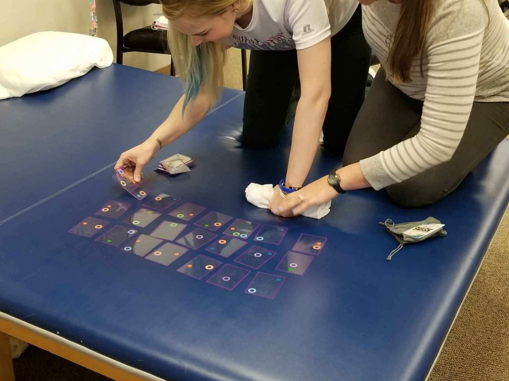 Occupational Therapist student working with patient