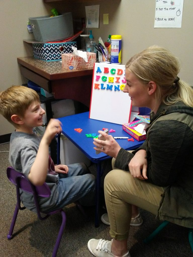 Speech Therapist working with patient